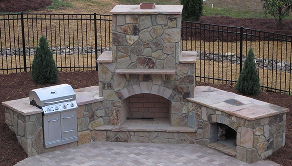 Anyone can build these easy affordable outdoor fireplace design plans. Create the ultimate outdoor living space with an outdoor fireplace.